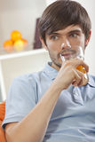 Man drinking orange juice Royalty Free Stock Images