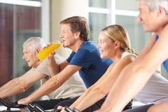 Man drinking orange juice in gym Royalty Free Stock Images