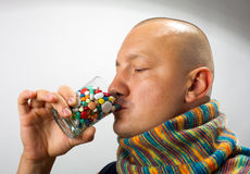Man drinking pills Stock Photo