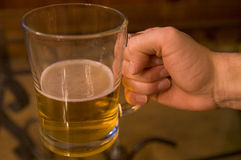 Man Drinking Pint Of Beer Stock Photography