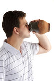 Man drinking from a pitcher Royalty Free Stock Image