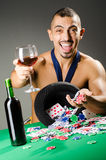 The man drinking and playing in casino Stock Photo