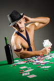 Man drinking and playing in casino Stock Photos