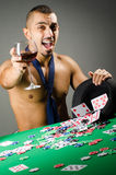 Man drinking and playing in casino Royalty Free Stock Photos