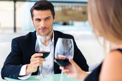 Man drinking red wine with his girlfriend Stock Photos