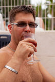 Man is drinking rosé wine Royalty Free Stock Photo