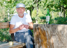 Man drinking and smoking outdoors Stock Photos