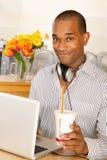 Man Drinking a Soda at the Computer Royalty Free Stock Image