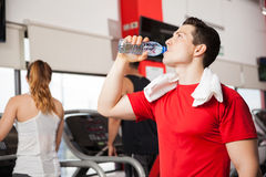 Man drinking some water in a gym Royalty Free Stock Images