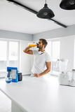 Man Drinking Sports Drink Before Training. Nutrition Supplements Stock Photos
