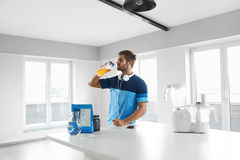 Man Drinking Sports Drink Before Training. Nutrition Supplements stock photography