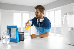 Man Drinking Sports Drink Before Training. Nutrition Supplements. Drinking Sports Drink. Healthy Handsome Happy Man With Muscular Body In Sportswear Drinking royalty free stock photo