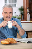 Man drinking tea for breakfast Stock Photo