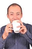 Man drinking a tea from a cup, isolated on white Stock Images