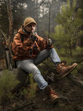 Man drinking tea with fishing rod. In the forest stock images