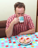 Man drinking tea Stock Images