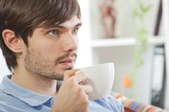 Man drinking tea and watching television Stock Photo