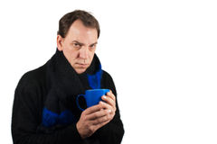 Man drinking tea in the winter time Stock Photos