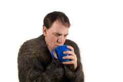 Man drinking tea in the winter time Stock Image