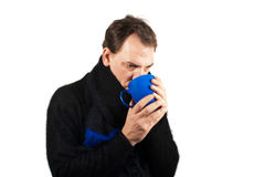 Man drinking tea in the winter time Stock Photography