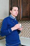 Man drinking tea Stock Images