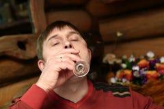 Man drinking vodka Royalty Free Stock Image