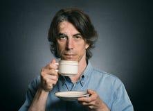 Man drinking warm beverage. Stock Photos