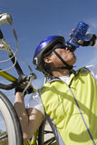 Man Drinking Water. Senior male cyclist drinking water Royalty Free Stock Photo