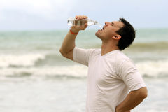 Man drinking water stock photography