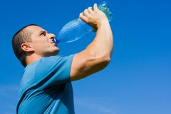 Man drinking water Stock Images