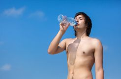 Man is drinking water from the bottle Royalty Free Stock Photography