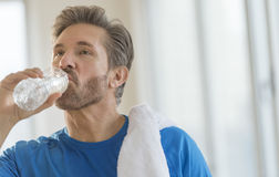 Man Drinking Water From Bottle After Exercising Royalty Free Stock Photo