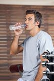 Man Drinking Water From Bottle At Health Club Stock Photography
