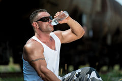Man Drinking Water After Exercise Stock Image