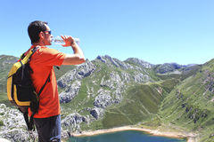 Man drinking water in front of a Saliencia& x27;s lake in Asturias Royalty Free Stock Photography