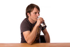 Man drinking water in a glass Royalty Free Stock Photos
