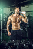 Man drinking water in gym Stock Photography