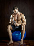 Man drinking water in gym Stock Image