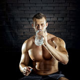 Man drinking water in gym Royalty Free Stock Photos