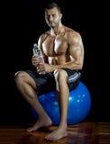 Man drinking water in gym Stock Photos