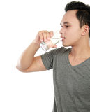 Man drinking water isolated over white background Royalty Free Stock Images
