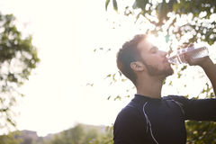 Man drinking water. In the nature Stock Photo