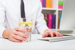 Man drinking water at office Stock Photography