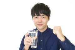Man drinking water. Portrait of handsome man drinking water stock images