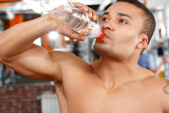 Man drinking water in sport gym Royalty Free Stock Image