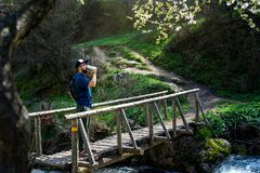 Man drinking water the wooden bridge outdoors stock photo