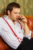 Man drinking whiskey Stock Photo