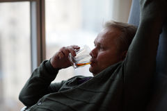 Man drinking whiskey Royalty Free Stock Image