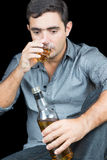 Man drinking from a whisky bottle (isolated on black) Stock Photos