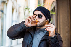 Man drinking whisky and holding a cigar Royalty Free Stock Photos